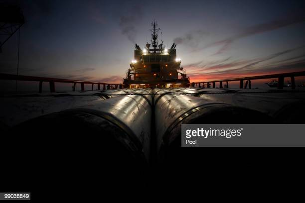 Risers the outer casings of oil drill pipes are seen on the deck of the service vessel Joe Griffin as it prepares to head to Port Fouchon at the site...