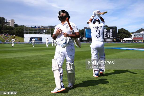 Rishabh Pant and Ajinkya Rahane of India take the field during day two of the First Test match between New Zealand and India at Basin Reserve on...
