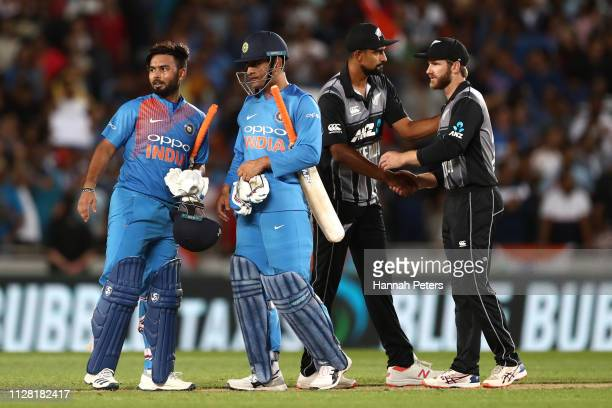 Rishabh Pant and MS Dhoni of India celebrate winning game two of the International T20 Series between the New Zealand Black Caps and India at Eden...