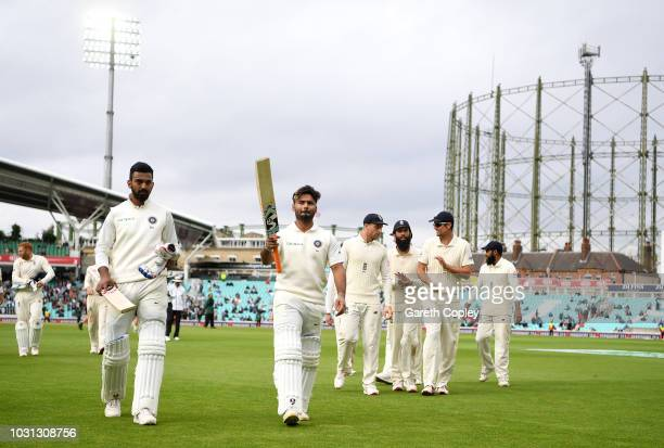 Rishabh Pant and Lokesh Rahul of India salute the crowd as they leave the field at tea during day five of the Specsavers 5th Test match between...