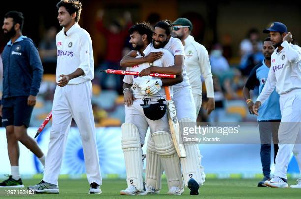 Rishabh Pant and Mohammed Siraj of India celebrate victory after day five of the 4th Test Match in the series between Australia and India at The...