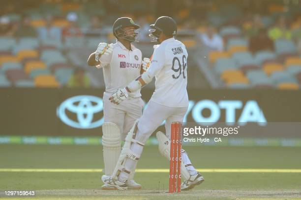Rishabh Pant and Navdeep Saini of India celebrate victor during day five of the 4th Test Match in the series between Australia and India at The Gabba...