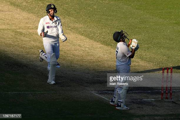 Rishabh Pant and Navdeep Saini of India celebrate victory during day five of the 4th Test Match in the series between Australia and India at The...