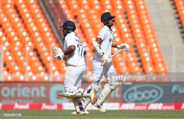Rishabh Pant and Washington Sundar of India pick up runs during Day Two of the 4th Test Match between India and England at Sardar Patel Stadium on...