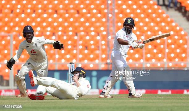 Rishabh Pant of India bats as Ollie Pope of England attempts to field watched on by Ben Foakes during Day Two of the 4th Test Match between India and...