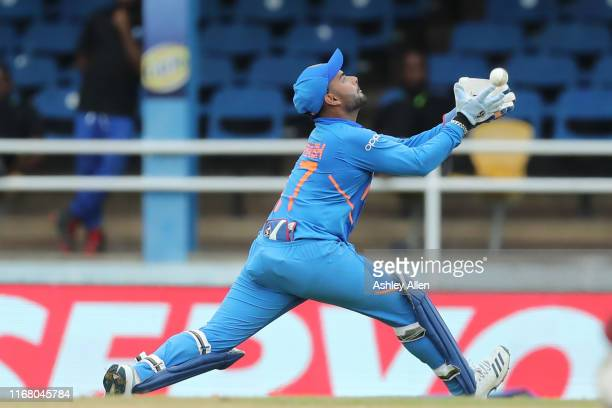 Rishabh Pant of India catches Carlos Brathwaite of the West Indies during the third MyTeam11 ODI between the West Indies and India at the Queen's...