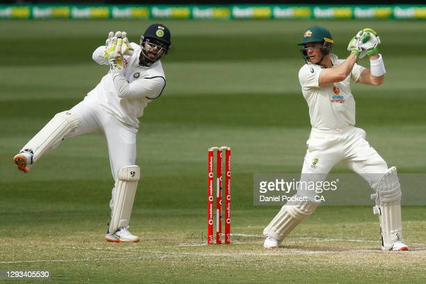 Rishabh Pant of India catches out Tim Paine of Australia during day three of the Second Test match between Australia and India at Melbourne Cricket...