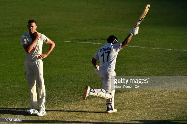 Rishabh Pant of India celebrates in front of Josh Hazlewood of Australia after his team's victory during day five of the 4th Test Match in the series...