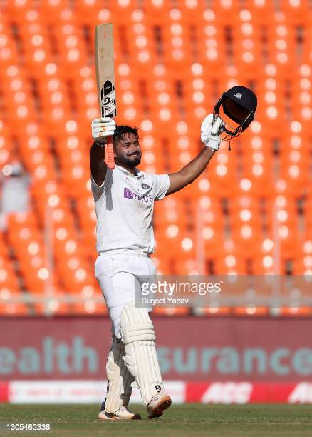Rishabh Pant of India celebrates reaching his century during Day Two of the 4th Test Match between India and England at the Narendra Modi Stadium on...