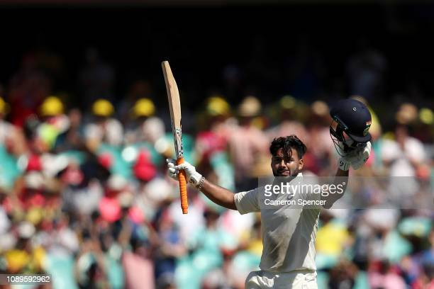 Rishabh Pant of India celebrates scoring a century during day two of the Fourth Test match in the series between Australia and India at Sydney...