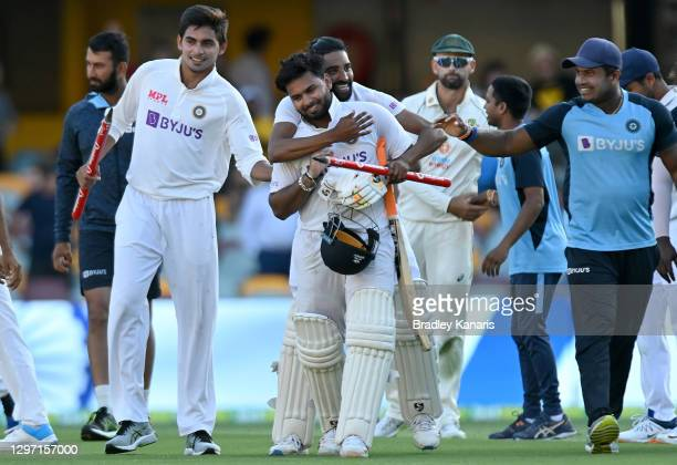 Rishabh Pant of India celebrates victory with his team mates after day five of the 4th Test Match in the series between Australia and India at The...