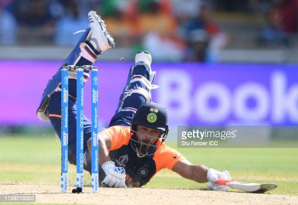 Rishabh Pant of India dives to make his ground as Eoin Morgan of England looks on during the Group Stage match of the ICC Cricket World Cup 2019...