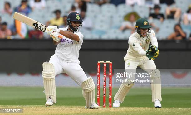 Rishabh Pant of India hits out watched by Tim Paine during day two of the Second Test match between Australia and India at Melbourne Cricket Ground...