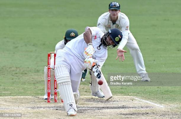 Rishabh Pant of India hits the ball over the boundary for a six during day five of the 4th Test Match in the series between Australia and India at...