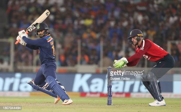 Rishabh Pant of India plays a shot as Jos Buttler of England looks on during the 2nd T20 International match between India and England at Narendra...