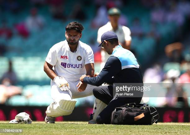 Rishabh Pant of India reacts after being struck by a delivery from Pat Cummins of Australia during day three of the 3rd Test match in the series...