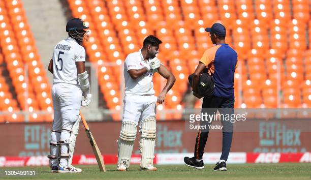 Rishabh Pant of India receives treatment after being struck during Day Two of the 4th Test Match between India and England at Sardar Patel Stadium on...