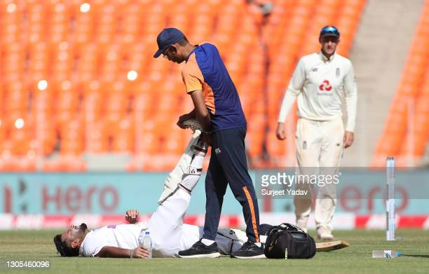 Rishabh Pant of India receives treatment during Day Two of the 4th Test Match between India and England at Sardar Patel Stadium on March 05, 2021 in...