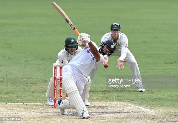 Rishabh Pant of India swings and misses as the ball races to the boundary for four byes during day five of the 4th Test Match in the series between...