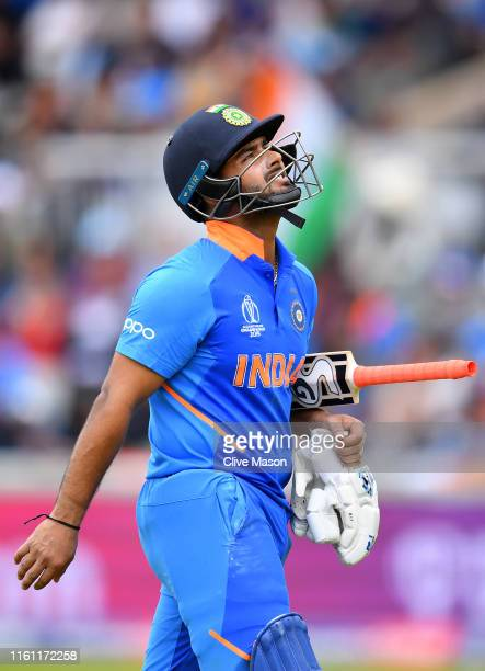 Rishabh Pant of India walks after being dismissed during resumption of the Semi-Final match of the ICC Cricket World Cup 2019 between India and New...
