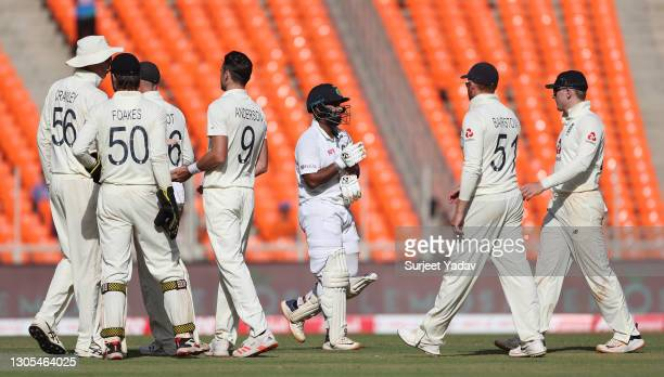 Rishabh Pant of India walks off after being dismissed as James Anderson of England and teammates celebrate during Day Two of the 4th Test Match...