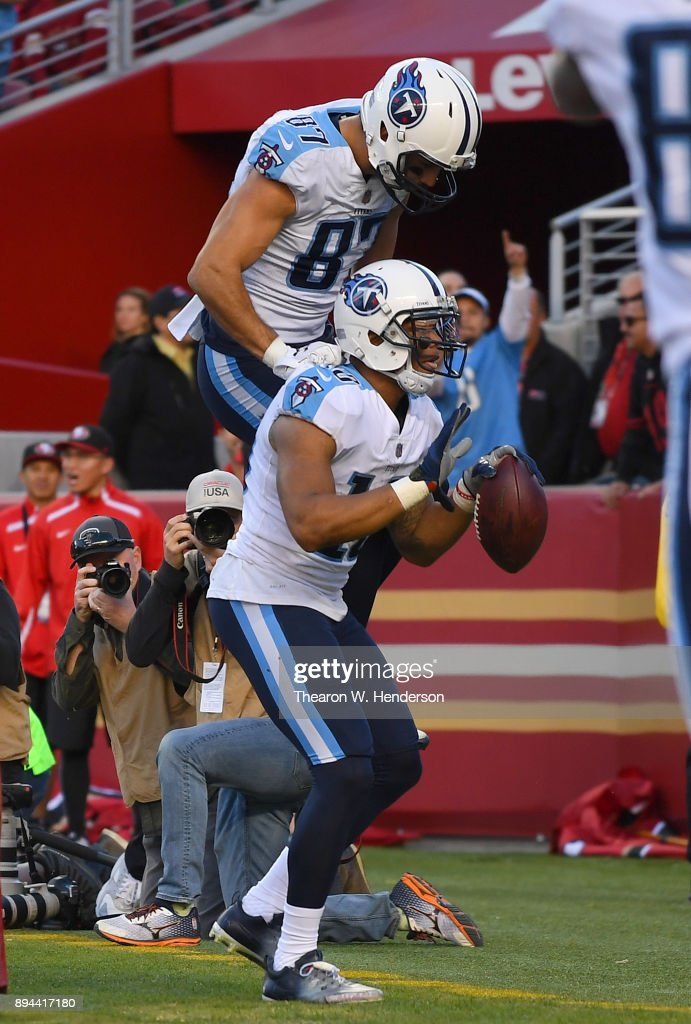 Rishard Matthews #18 and Eric Decker #87 of the Tennessee Titans celebrates after Matthews caught a touchdown pass against the San Francisco 49ers during their NFL football game at Levi's Stadium on December 17, 2017 in Santa Clara, California.