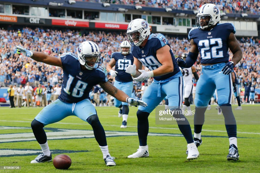 Rishard Matthews #18 of the Tennessee Titans celebrates with teammates after a touchdown during the first half against the Baltimore Ravens at Nissan Stadium on November 5, 2017 in Nashville, Tennessee.
