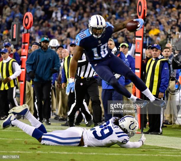 Rishard Matthews of the Tennessee Titans jumps over Malik Hooker of the Indianapolis Colts during the second half of a 3622 Titan victory at Nissan...