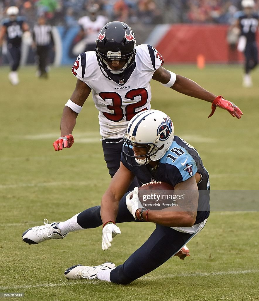 Rishard Matthews #18 of the Tennessee Titans makes a 50 yard reception against Robert Nelson #32 of the Houston Texans during the second half at Nissan Stadium on January 1, 2017 in Nashville, Tennessee.