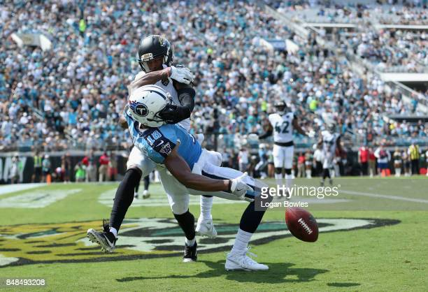 Rishard Matthews of the Tennessee Titans tries to make a catch in front of AJ Bouye of the Jacksonville Jaguars during the second half of their game...