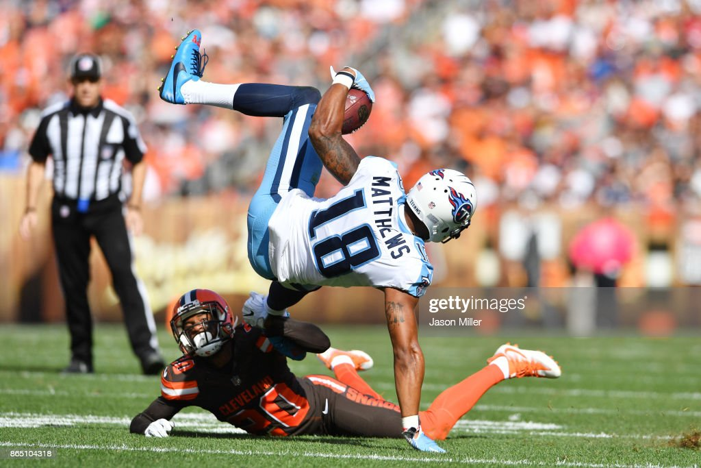 Rishard Matthews #18 of the Tennessee Titans tumbles through the air after being tackled by Briean Boddy-Calhoun #20 of the Cleveland Browns in the second quarter at FirstEnergy Stadium on October 22, 2017 in Cleveland, Ohio.