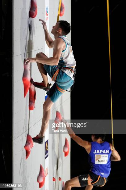 Rishat Khaibullin of Kazakhstan and Tomoa Narasaki of Japan compete in the Speed during Combined Men's Final on day eleven of the IFSC Climbing World...