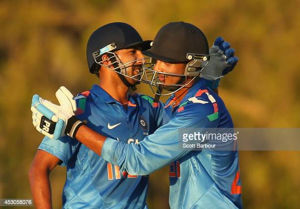 Rishi Dhawan and Akshar Patel of India 'A' celebrate after winning the match during the Cricket Australia Quadrangular Series Final match between...