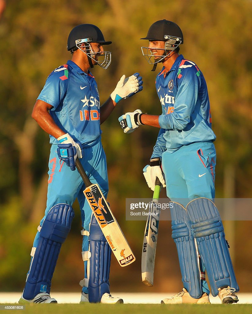 Rishi Dhawan and Akshar Patel of India 'A' celebrate after winning the match during the Cricket Australia Quadrangular Series Final match between Australia 'A' and India 'A' at Marrara Oval on August 2, 2014 in Darwin, Australia.