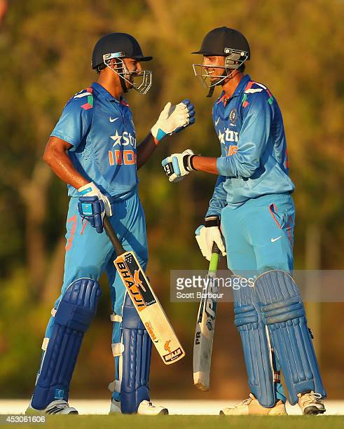 Rishi Dhawan and Akshar Patel of India 'A' celebrate after winning the match during the Cricket Australia Quadrangular Series Final match between...