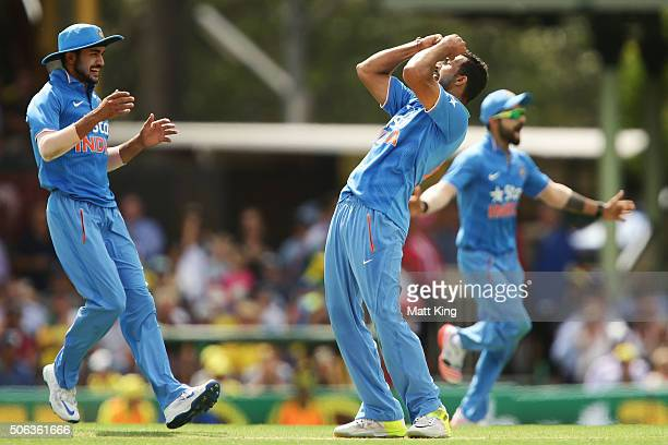 Rishi Dhawan of India celebrates taking the wicket of George Bailey of Australia during game five of the Commonwealth Bank One Day Series match...
