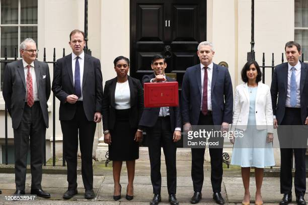 Rishi Sunak Chancellor of the Exchequer departs to deliver the annual Budget at Downing Street with members of the Treasury staff Minister of State...