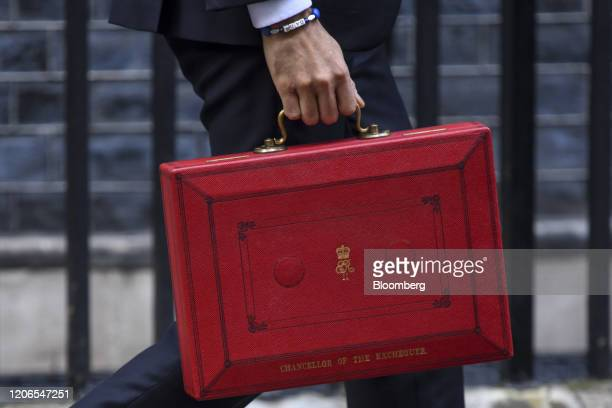 Rishi Sunak, U.K. Chancellor of the exchequer, carries a dispatch box as he departs from number 11 Downing Street to present the budget in Parliament...