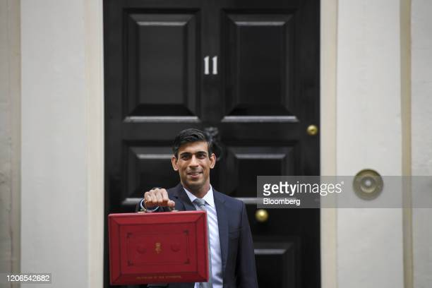 Rishi Sunak UK chancellor of the exchequer holds a dispatch box as he departs from number 11 Downing Street to present the budget in Parliament in...