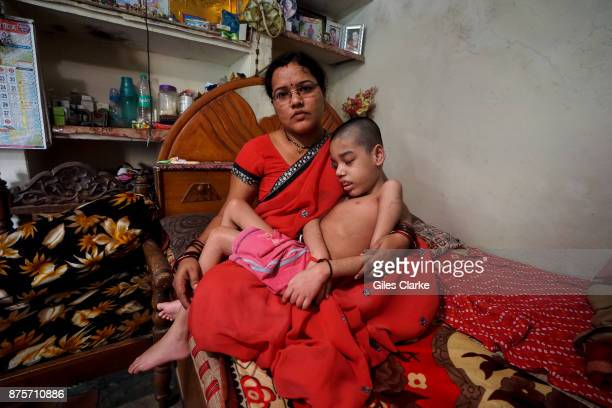 Rishikesh 8 years old with his mother Sangeeta at home in the Pushpa Nagar neighborhood Rishikesh was born to parents contaminated by a carcinogenic...