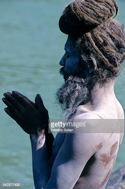 Rishikesh located in the foothills of Himalaya is an important center of pilgrimage for Hindus Sadhu practicing yoga near the sacred river Ganges