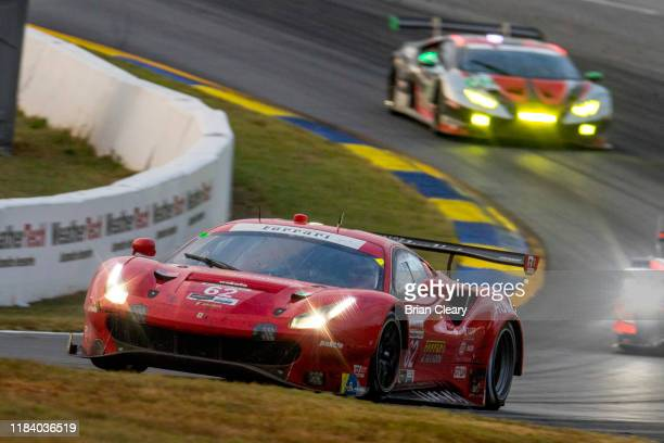 Risi Competizione Ferrari 488 GTE GTLM of James Calado Alessandro Pier Guidi and Daniel Serra races at dusk Petit Le Mans IMSA WeatherTech Series...