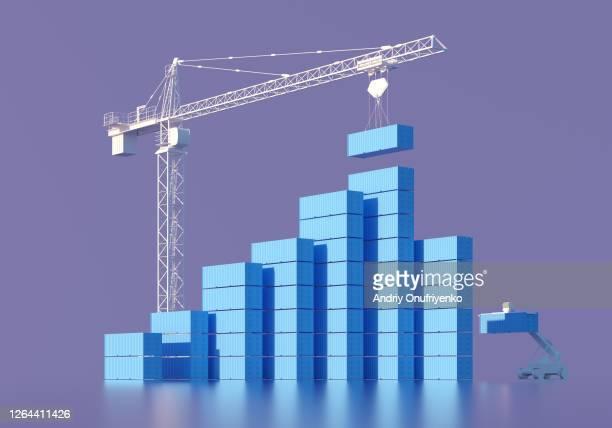rising bar graph made of containers - balkendiagramm stock-fotos und bilder
