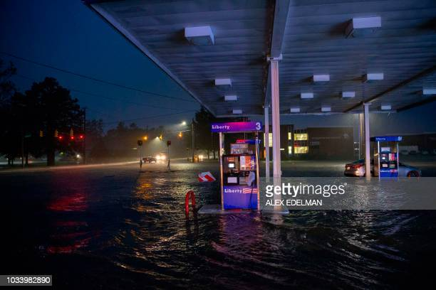 TOPSHOT Rising flood waters overtake a gas station in Lumberton North Carolina on September 15 2018 in the wake of Hurricane Florence Besides federal...