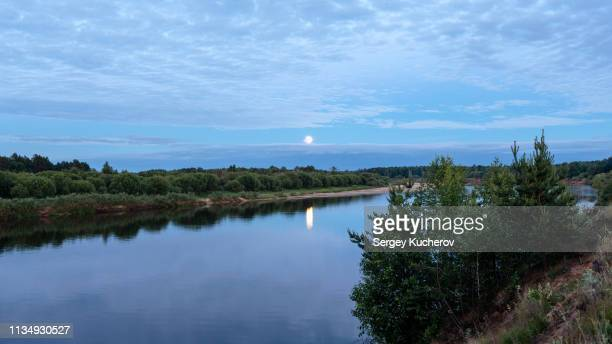 rising moon over the river vetluga - nizhny novgorod oblast stock photos and pictures