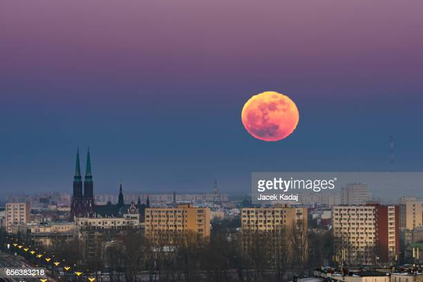 Rising moon over Warsaw