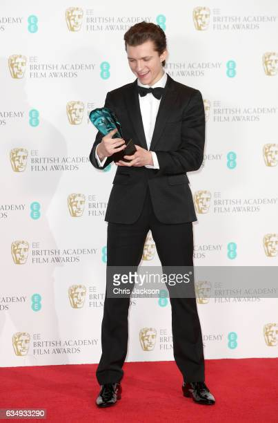 Rising Star winner actor Tom Holland poses with his award in the winners room during the 70th EE British Academy Film Awards at Royal Albert Hall on...