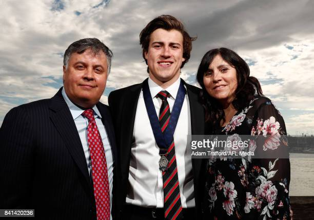 Rising star winner Andrew McGrath of the Bombers poses for a photo with parents Michael and Sandy McGrath during the 2017 NAB AFL Rising Star awards...