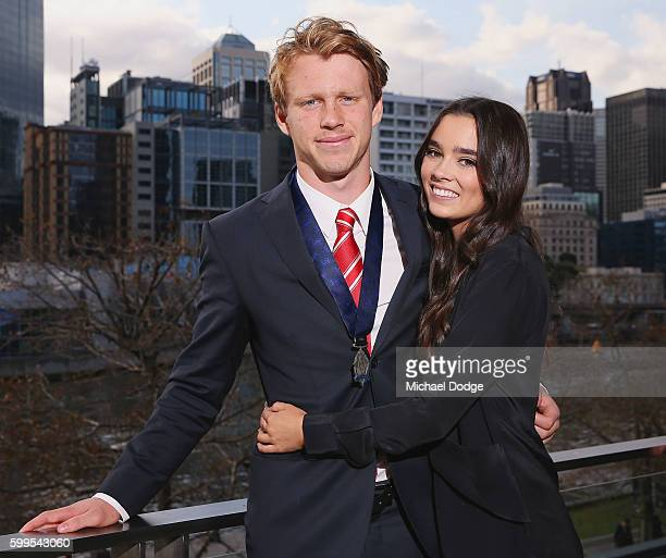Rising Star winner Callum Mills of the Swans poses with girlfriend Tiffany Browne during the 2016 AFL Rising Star Announcement at Crown Palladium on...