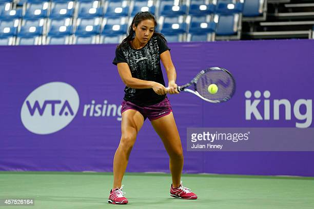 Rising Star Zarina Diyas of Kazakhstan warms up before the sponsor pro am during day one of the BNP Paribas WTA Finals tennis at the Singapore Sports...